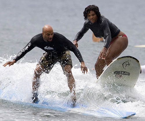 Serena Williams with Common surfing in Hawaii