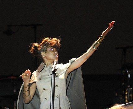Erykah Badu Rocks Shaved Sides, Messy Bun & Cape for Nice Jazz Festival