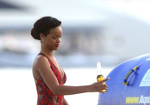 Rihanna Goes Red, Rocks Conservative One Piece Bathing Suit