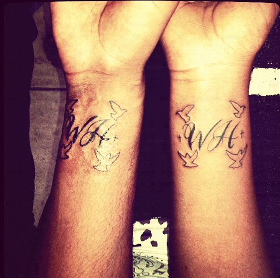 The wrist tattoos, include the letters WH (Whitney's initials), four ...