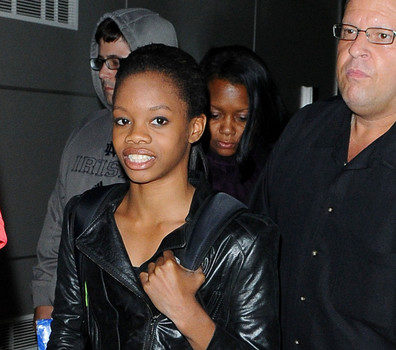 Gymnast Chic : Gabby Douglas Hits JFK In Metallic Gold Skirt & Flip Flops