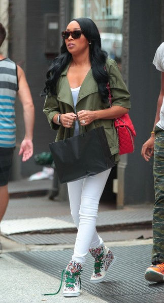 a casually dressed monica shops in new york