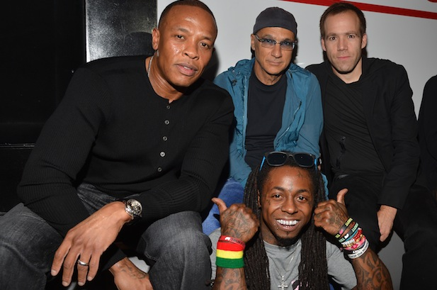 Dr. Dre, Interscope head Jimmy Iovine, president/COO of Beats Electronics Luke Wood, and Lil Wayne