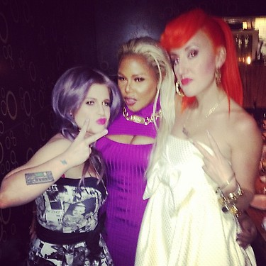 Lil Kim Makes Fashion Week Rounds With Kelly Osbourne & Betsey Johnson