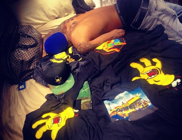 Rihanna Snaps A Photo of Chris Brown Chest-Naked In Bed