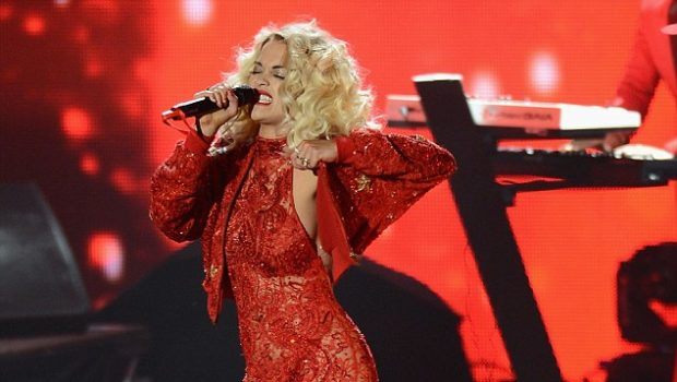 Haute or Hot A** Mess: Rita Ora's Sneakers & Revealing Lacy Jumper