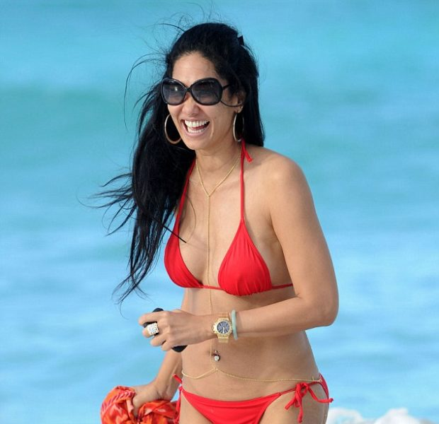 Kimora Lee Simmons Puts On Her Happy Face & Bikini for Christmas in St. Barts