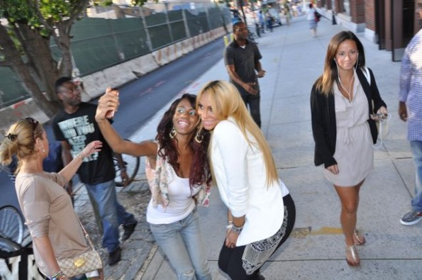 Fans stop Tamar for a cell phone pic