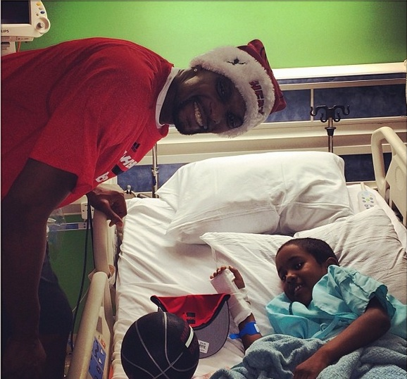 christopher bosh-miami heat-deliver christmas gifts-visit hospital 2013-the jasmine brand