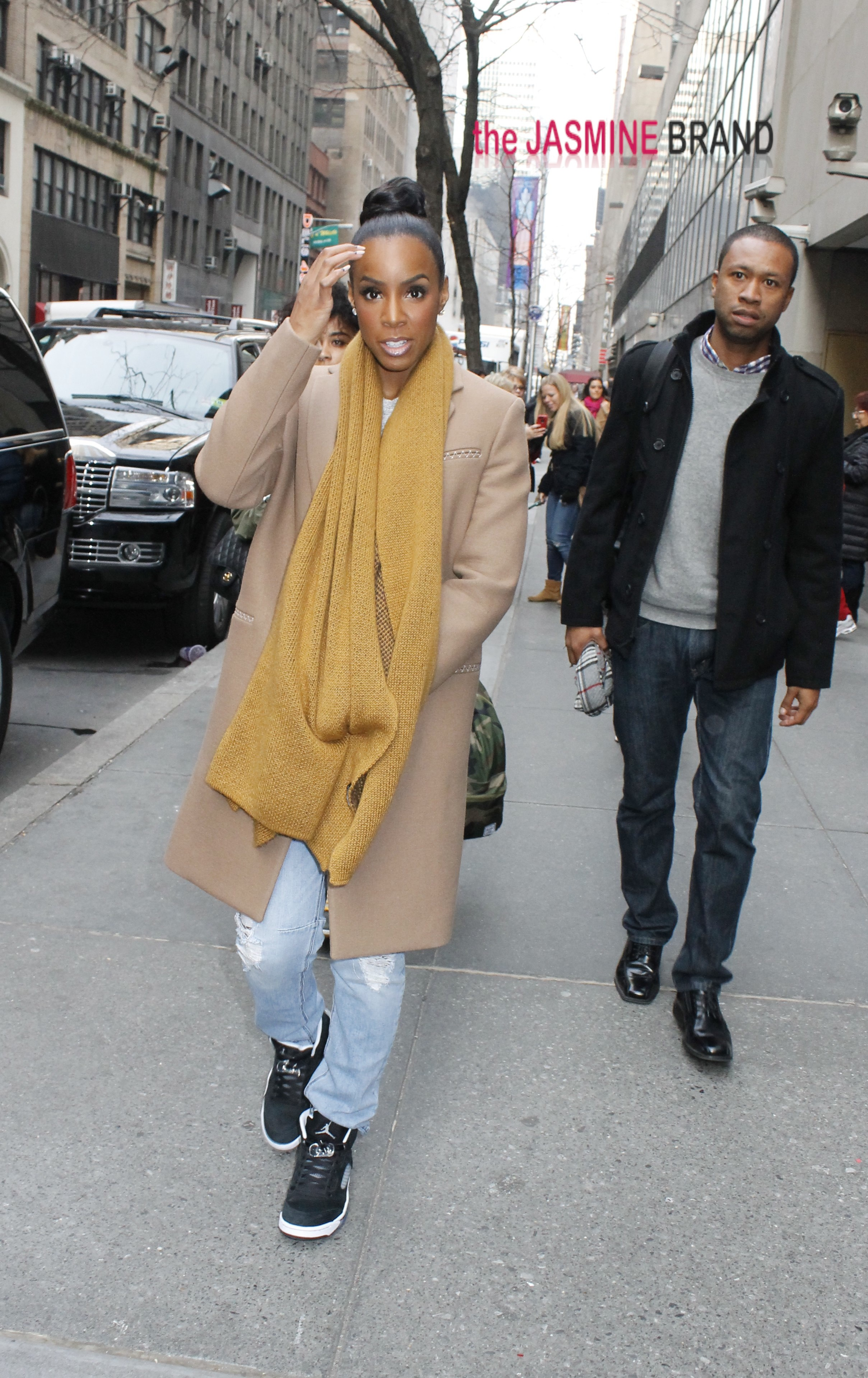 Comfy and casual in a camel colored coat and black 'kicks', Kelly Rowland leaves the 'Today' show studios in NYC