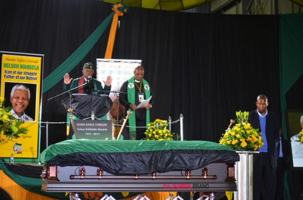 Casket containing the body of Nelson Mandela draped in Mandela's lifetime political party African National Congress' (ANC) flag at Waterkloof Air Force Base