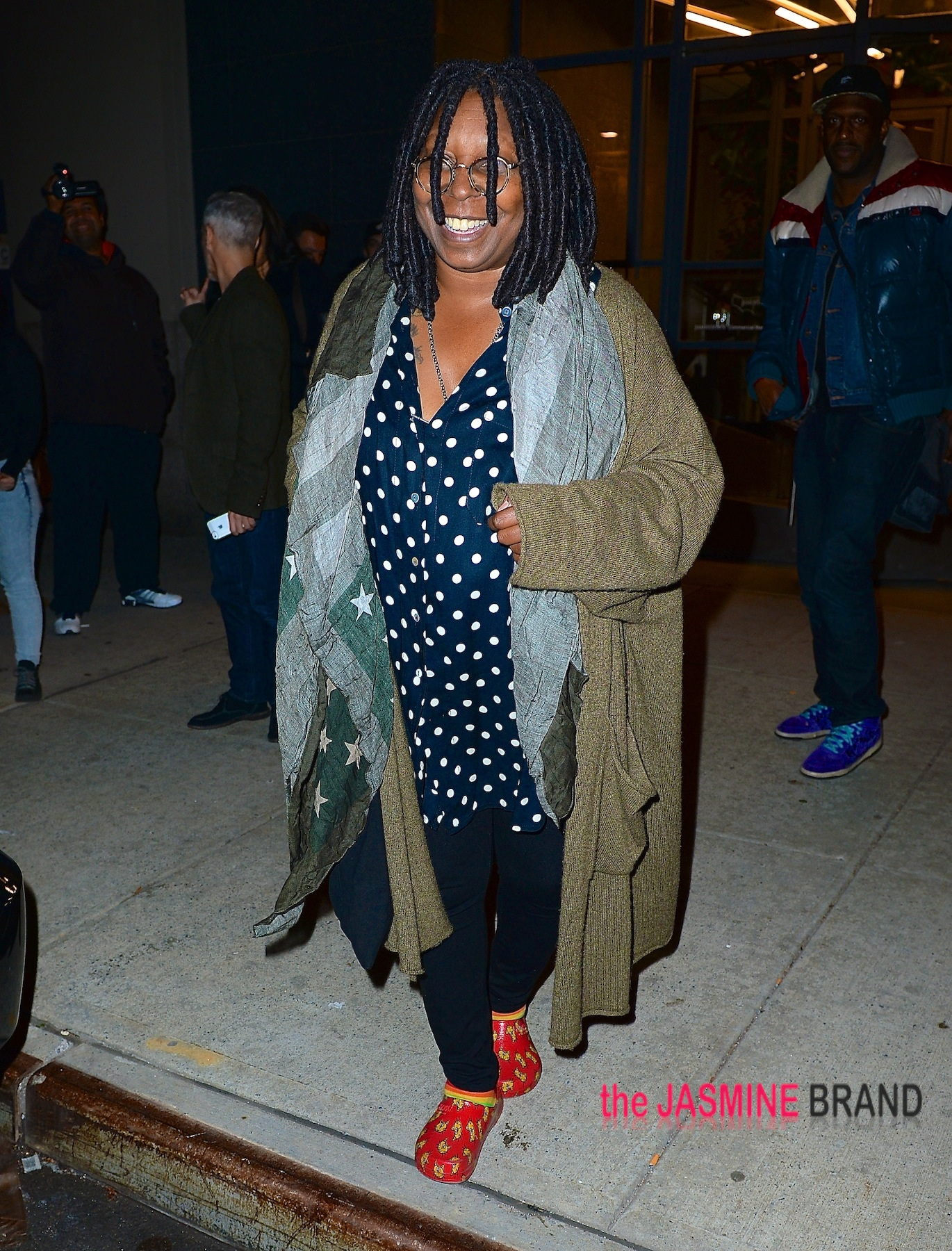 Whoopi Goldberg spotted in NYC wearing red cat clogs and rainbow socks