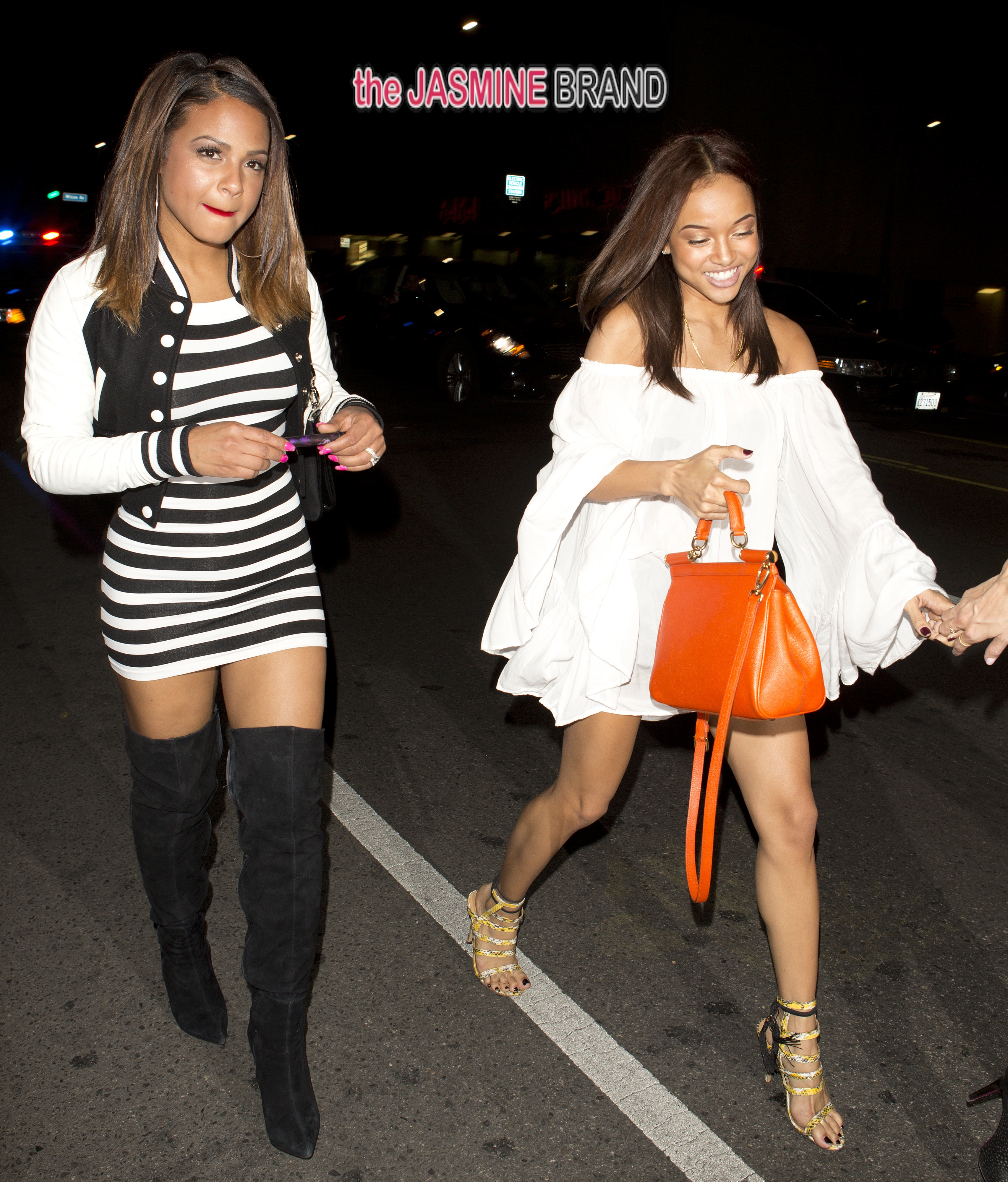 While Chris Brown is in rehab, girlfriend Karrueche Tran goes out clubbing with singer Christina Milian in Hollywood, CA