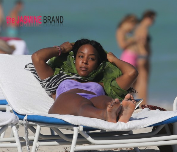 Kelly Rowland takes to Miami Beach in a purple bikini
