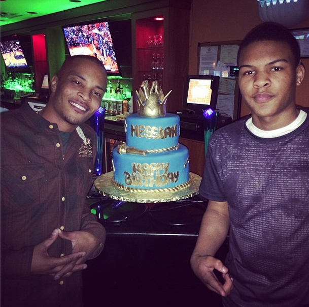 photos rapper ti buys 14yearold son new car for