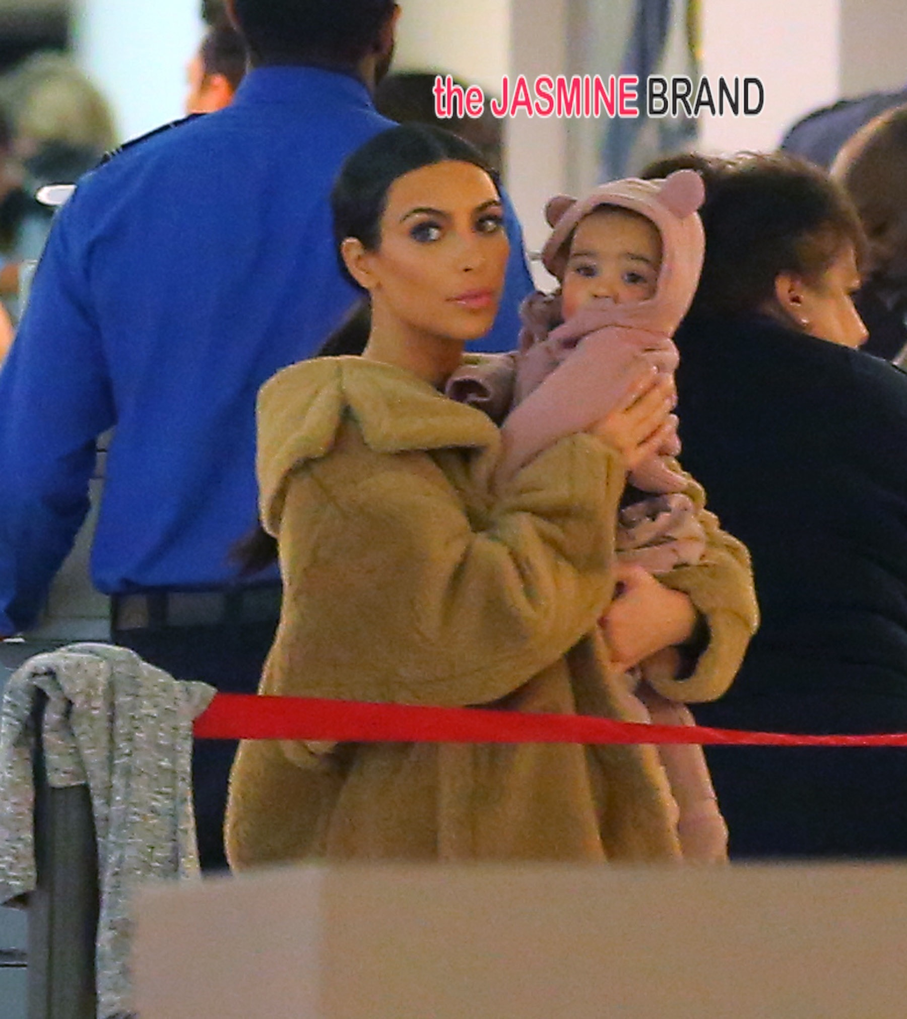 Kim Kardashian holds baby North West while wearing a fur coat NYC