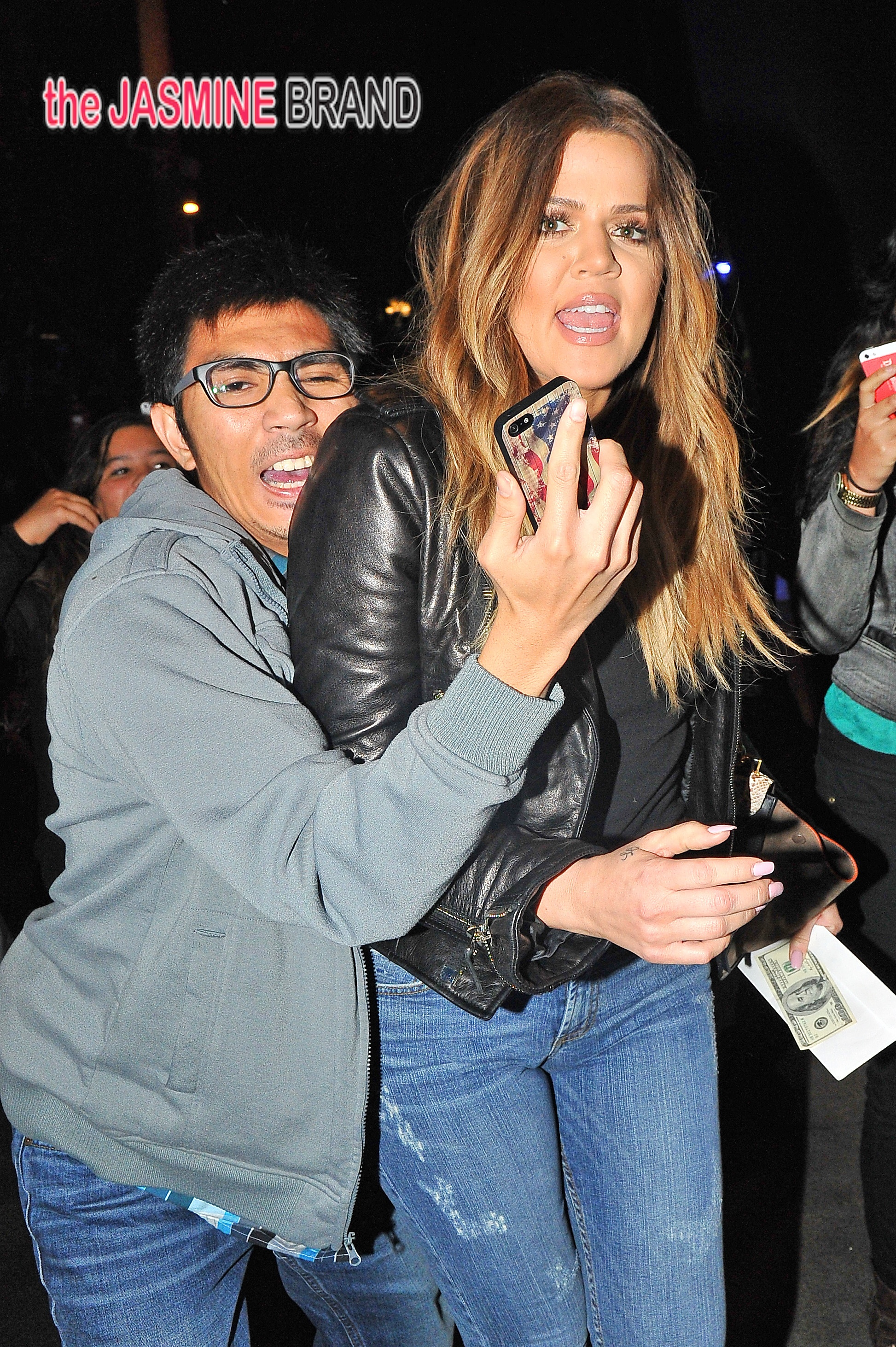 Khloe Kardashian is grabbed by an over excited fan