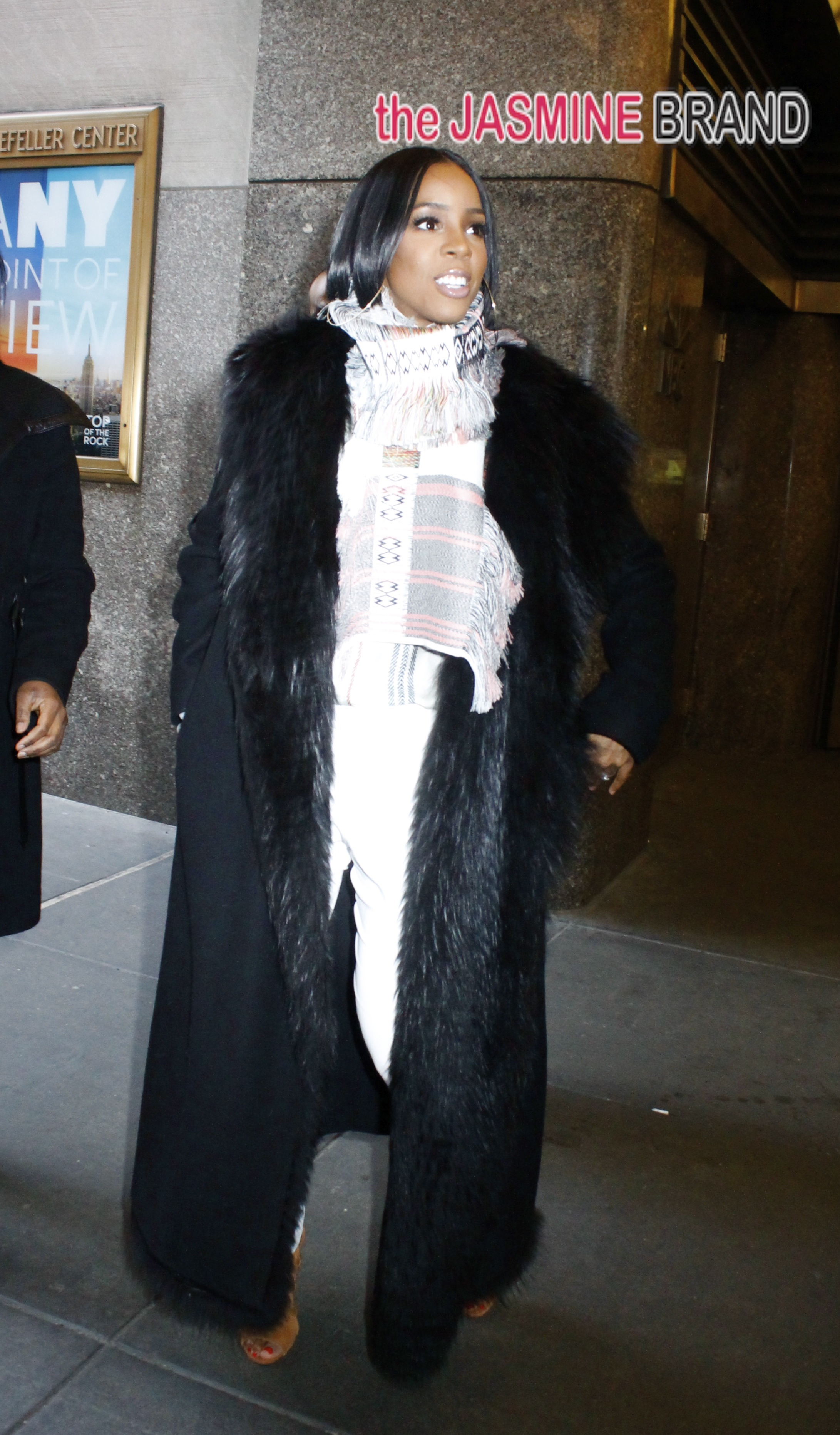 Looking fabulous in a full length fur Kelly Rowland leaves the NBC Studios in NYC