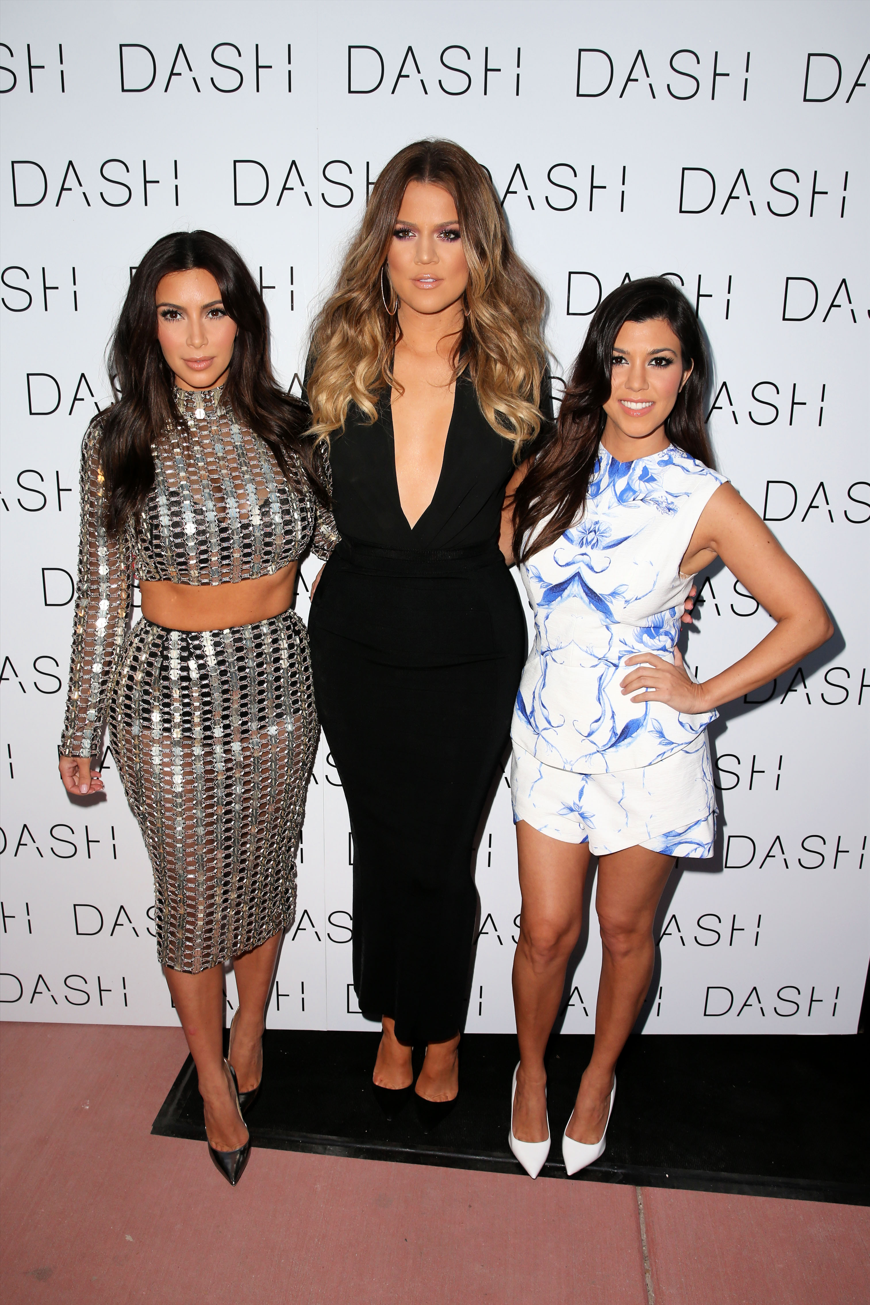 TV personality Kim Kardashian, wearing a silver sequined dress, arrives at the Grand Opening of the DASH store in Miami Beach, Florida