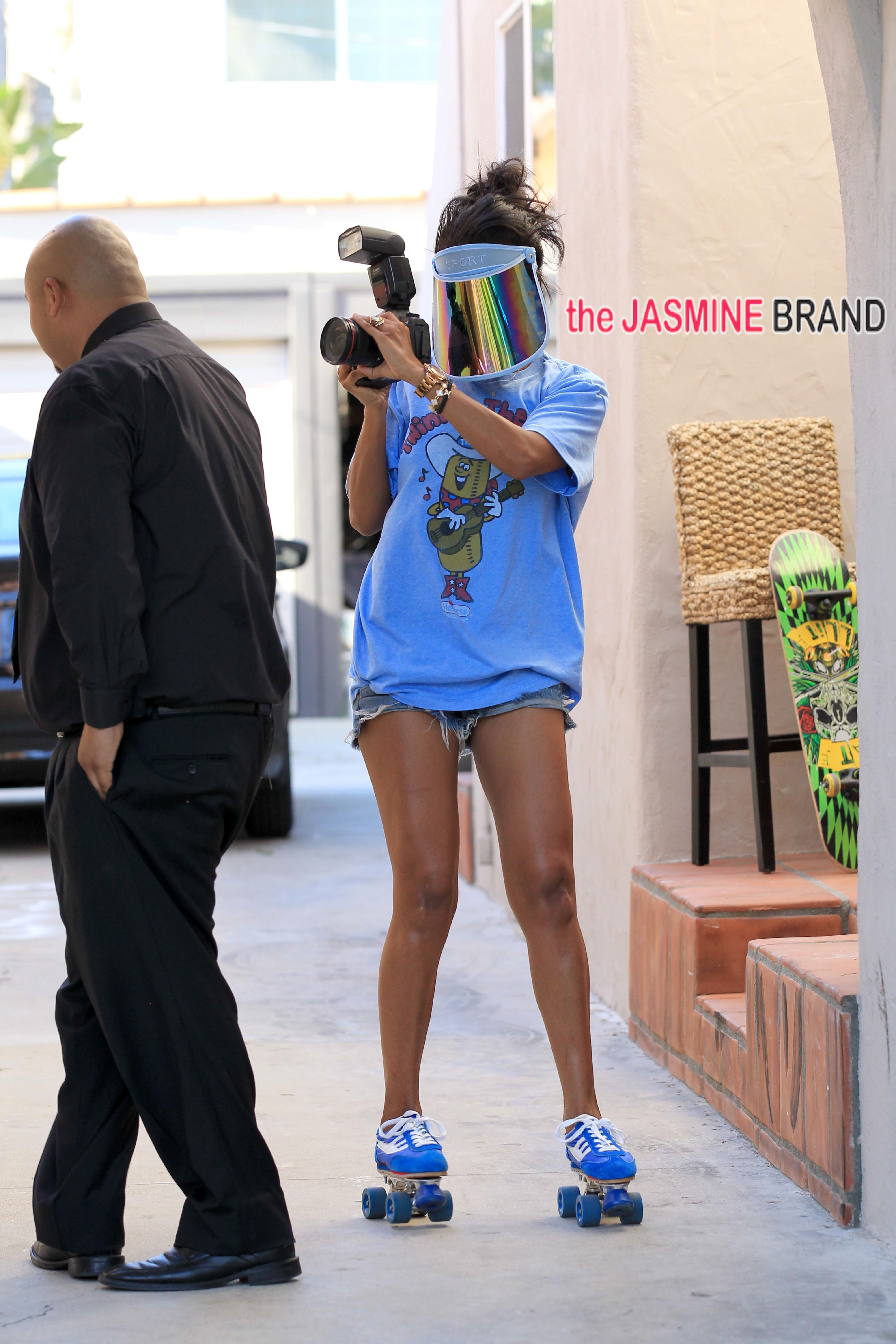 V. Stiviano dances on roller skates and takes photos of awaiting press