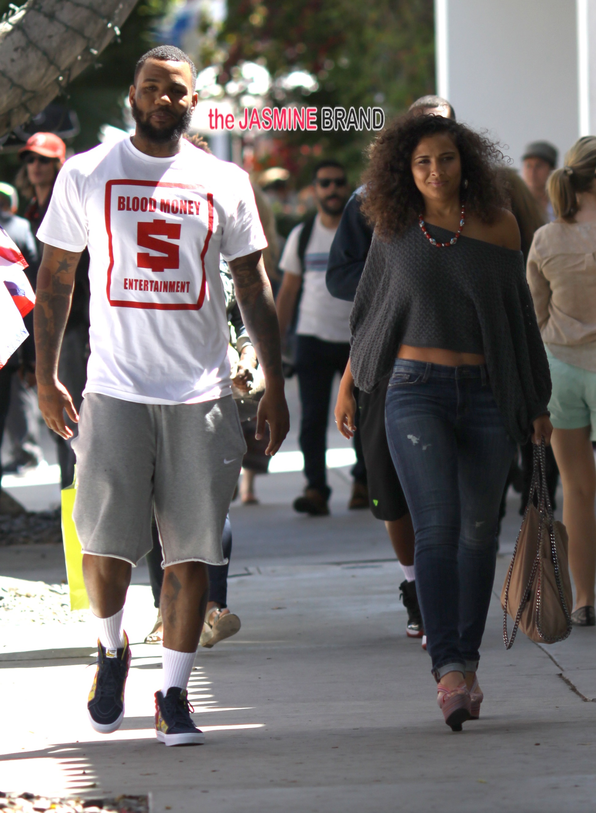 Rapper 'The Game' and a female companion shopping at Kitson in West Hollywood