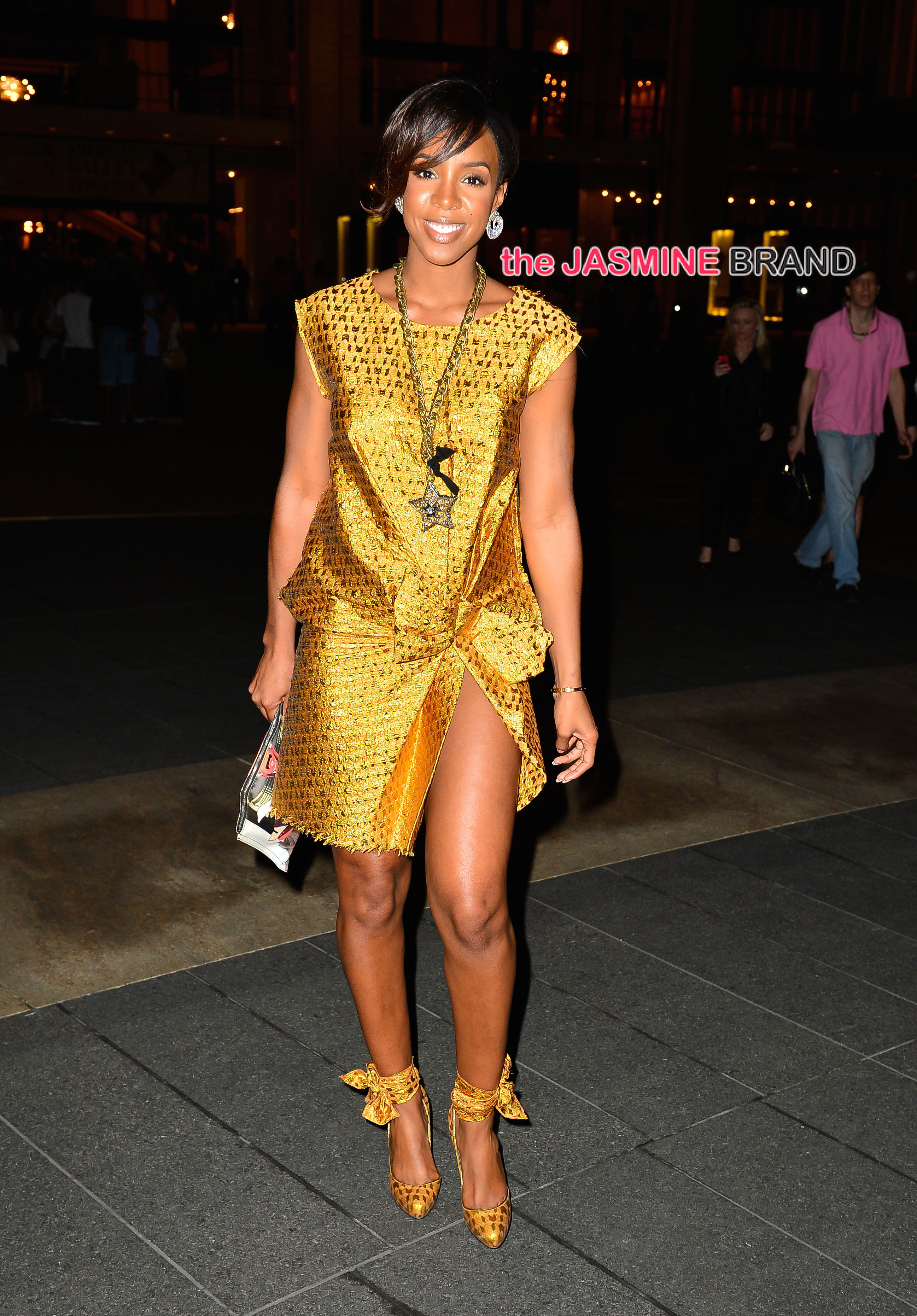 Kelly Rowland wears a gold dress out in Manhattan, NYC