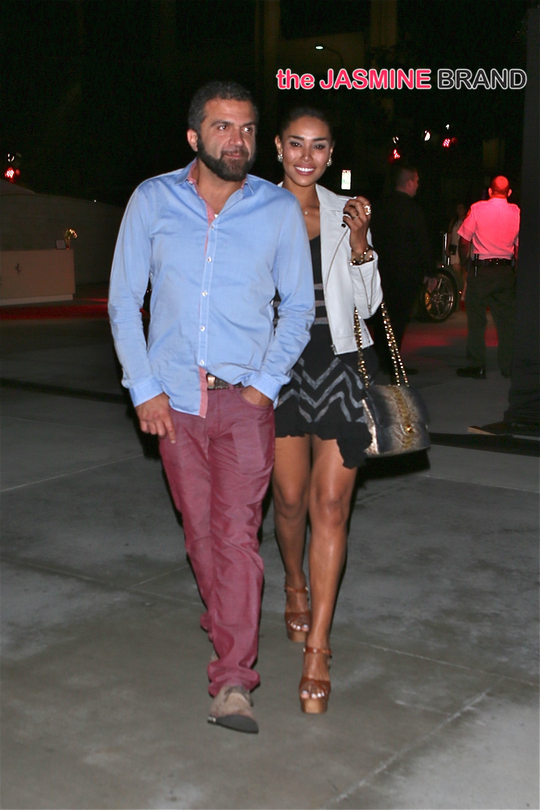 V. Stiviano attends the State of the Art Ferrari event with male friend