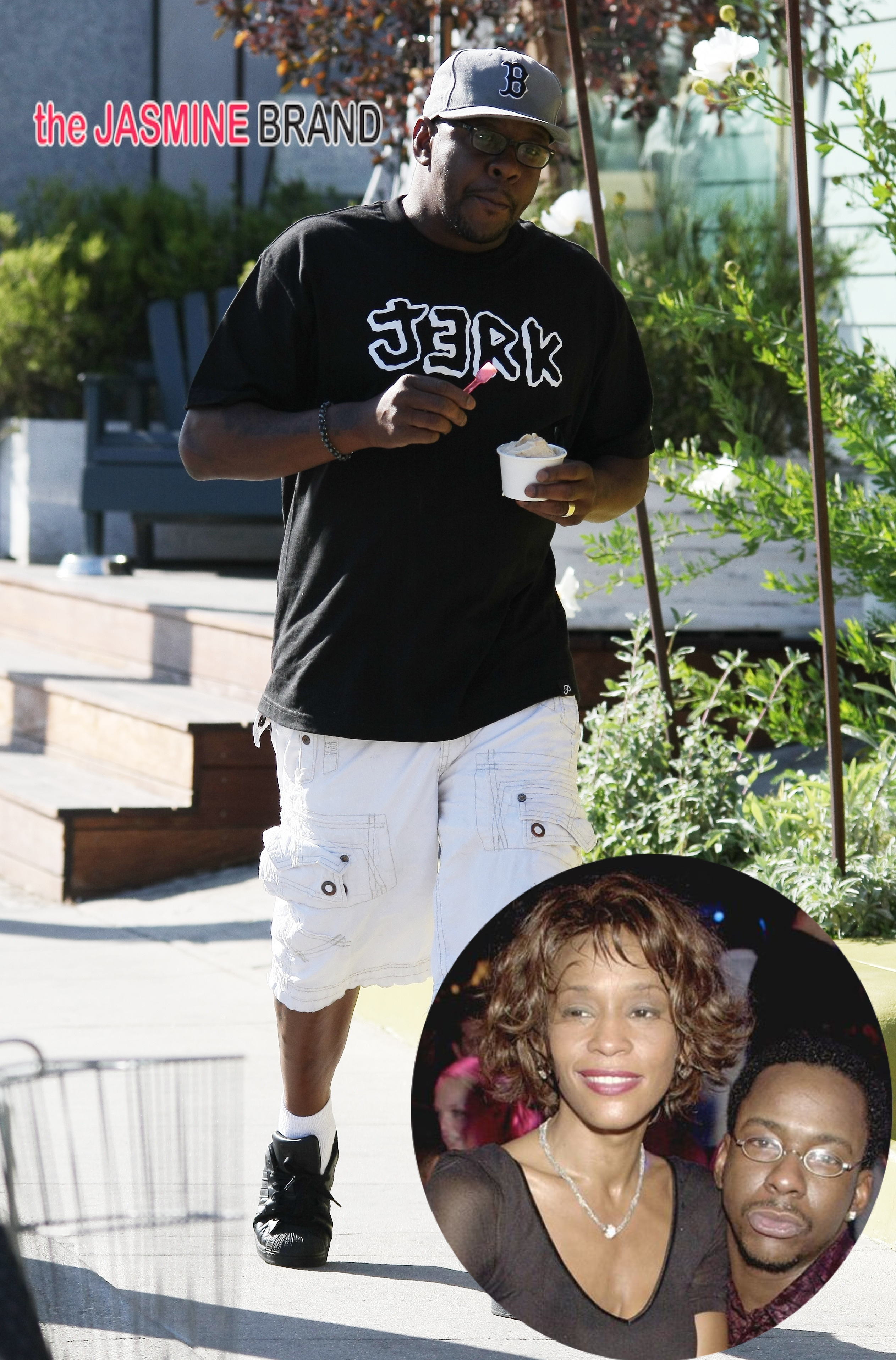Singer Bobby Brown multitasks as he eats his yogurt and chats on the phone while walking on Abbot Kinney in Venice, CA