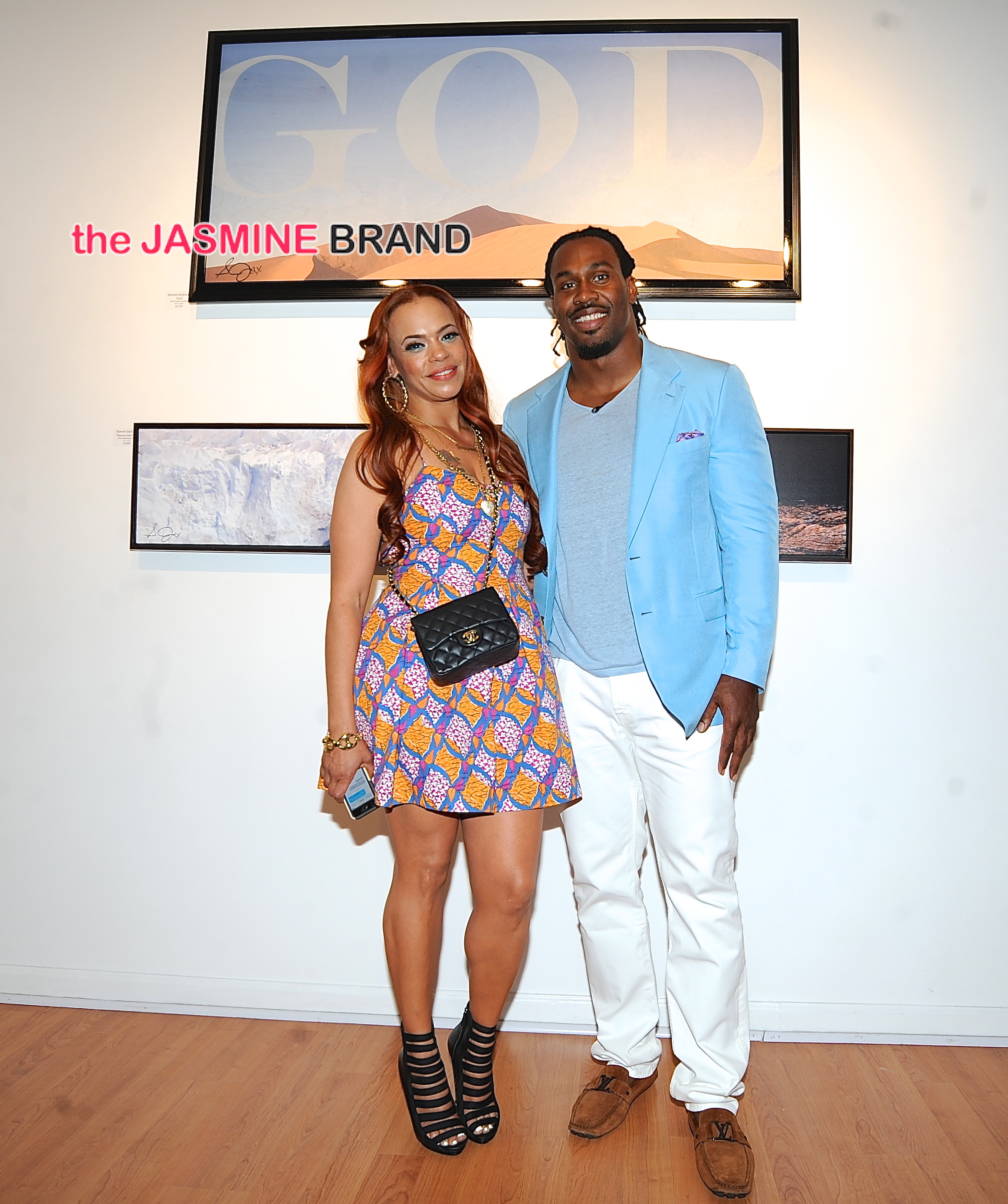 Faith Evans attends Steven Jackson's art gallery show. T.O and others attend in support