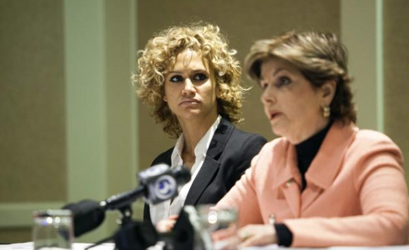 Hope Davila (L), who claims she was assaulted at a hotel by her former boyfriend, former NFL star Hugh Douglas, looks on during a news conference to announce a lawsuit filed in the United States District Court in Connecticut, with her attorney Gloria Allred (R) in Hartford, Connecticut April 28, 2014. Douglas, a former NFL football player for the New York Jets, Philadelphia Eagles and the Jacksonville Jaguars, in February 2014 pleaded no contest .