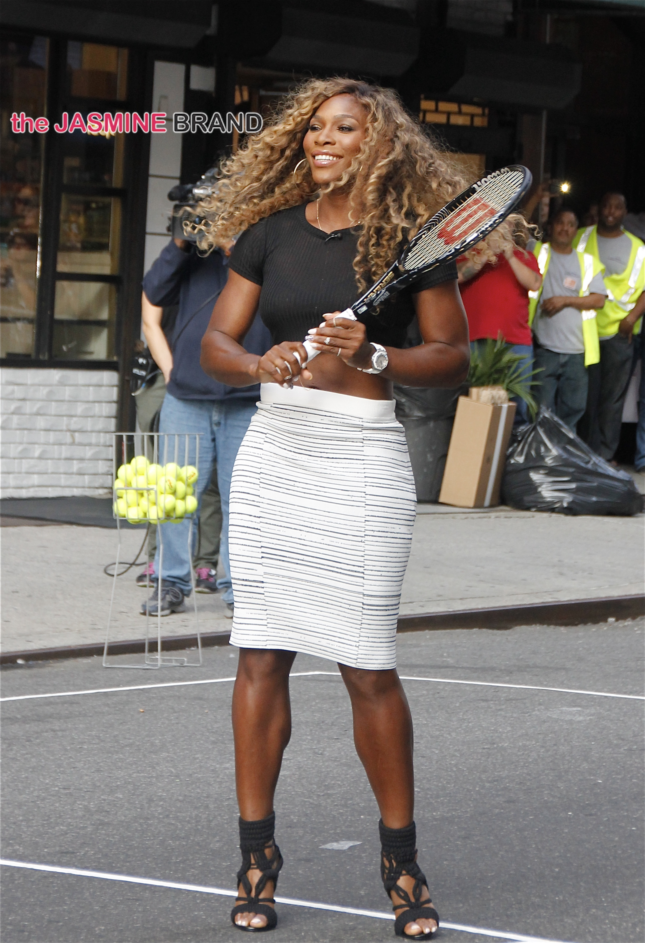 Wearing high heels and a curve-hugging skirt, Serena Williams plays tennis with David Letterman outside of the 'Late Show with David Letterman' studios in NYC