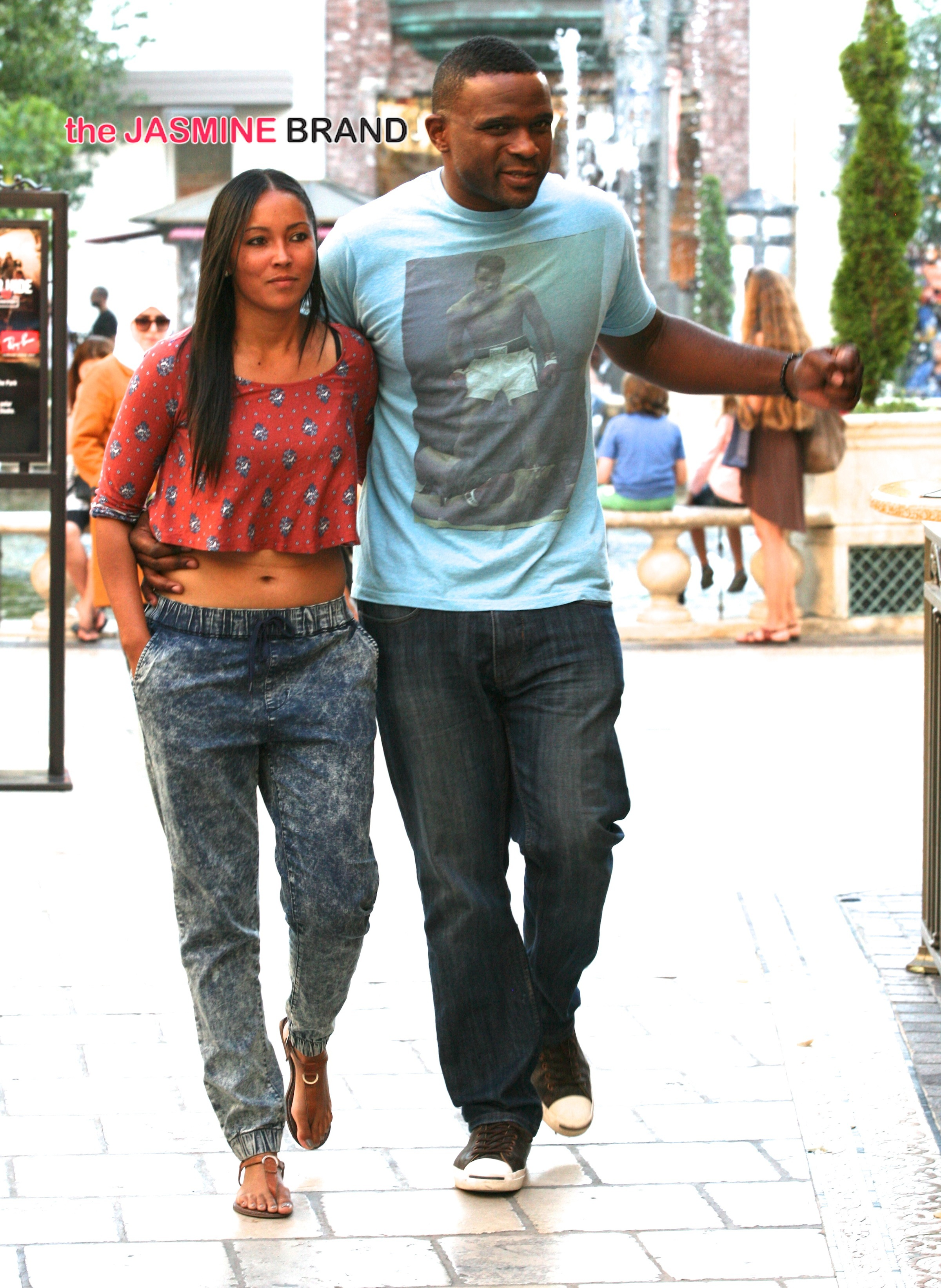Darius McCrary and his fiancee look happy while shopping at The Grove in West Hollywood, CA