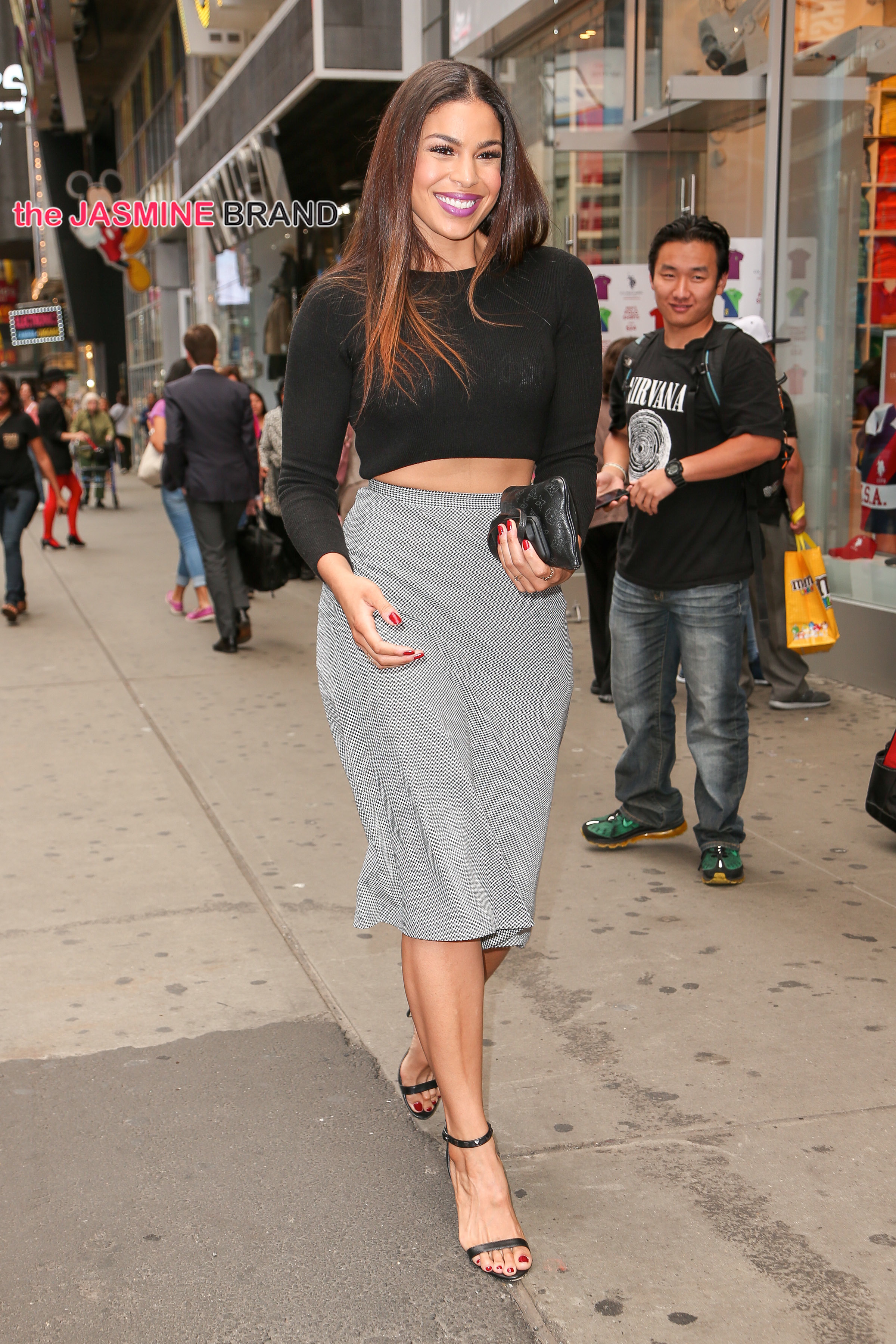 Jordin Sparks spotted smiling as wearing a midriff top and grey skirt while walking in Times Square, New York City