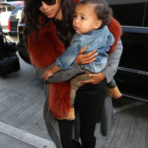 Kim Kardashian and baby North leaving LAX Airport, Kim Was in a long coat