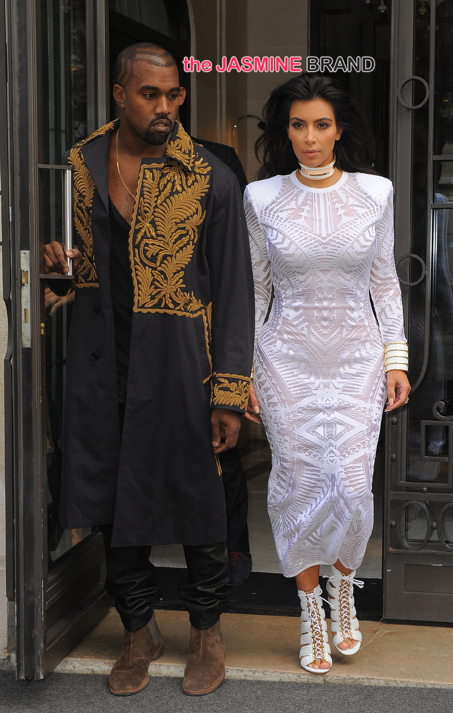 Kim and Kanye head to Balmain fashion show with mother Kris