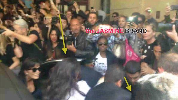 [VIDEO] Prankster Attempts to Tackle Kim Kardashian at Paris Fashion Week