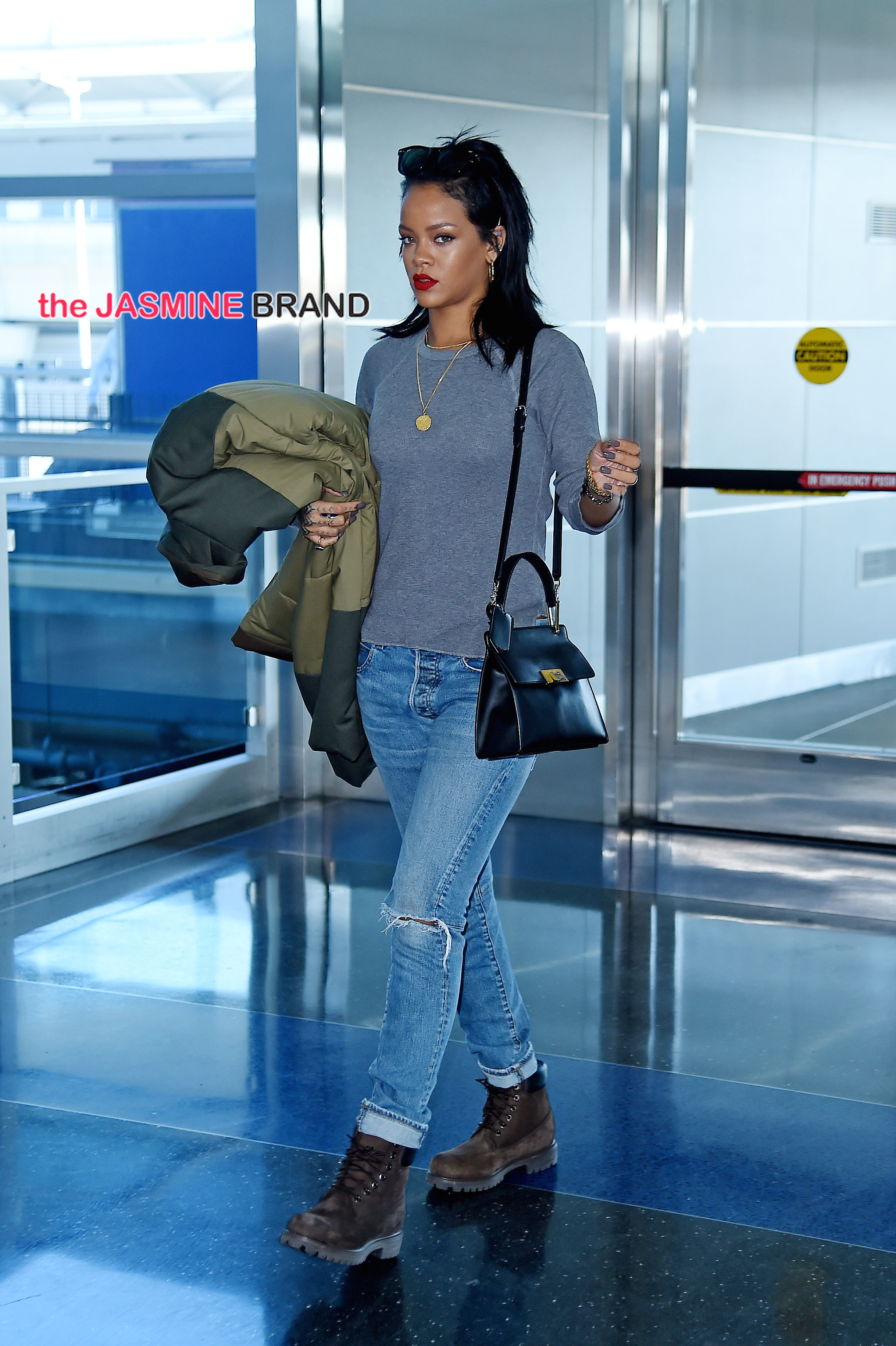 Rihanna looks stylish in ripped jeans as she strolls through JFK airport, NYC