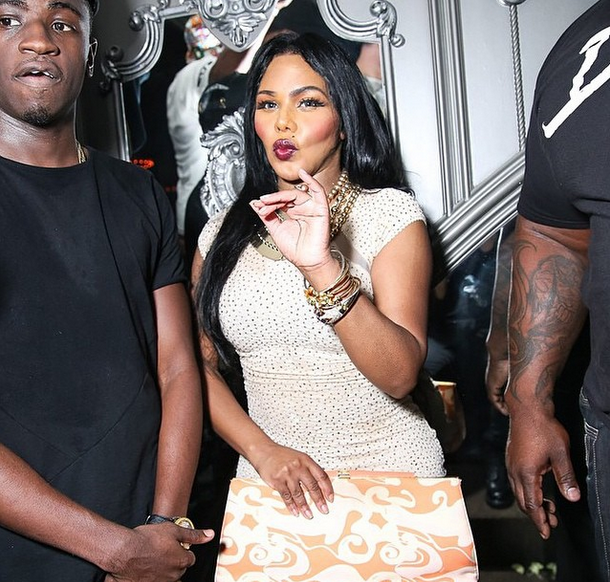 Lil Kim Shows Off Post-Pregnancy Figure, Performs At Up & Down Nightclub