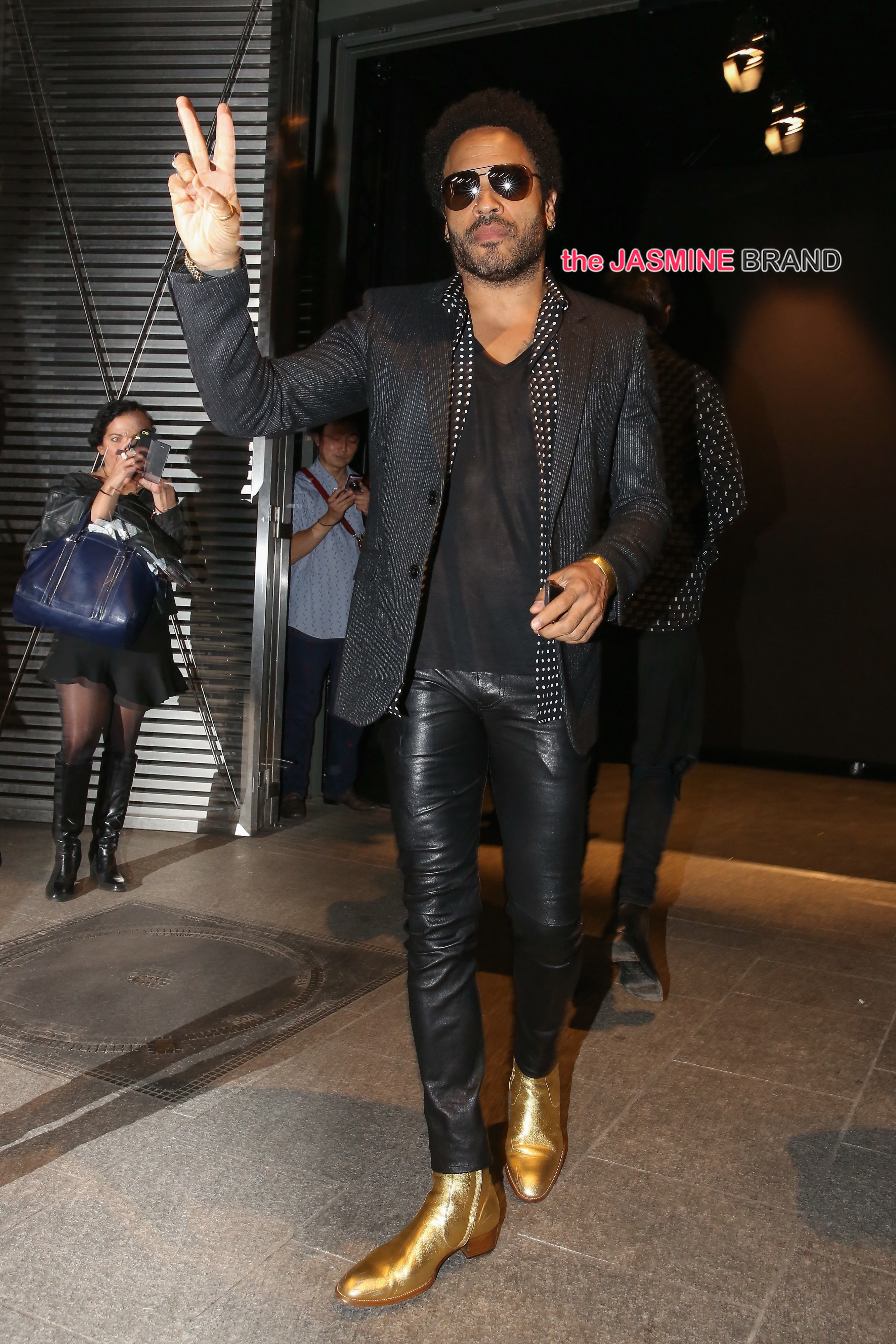Salma Hayek, Lenny Kravitz and Francois-Henri Pinault attend the Saint Laurent fashion show in Paris