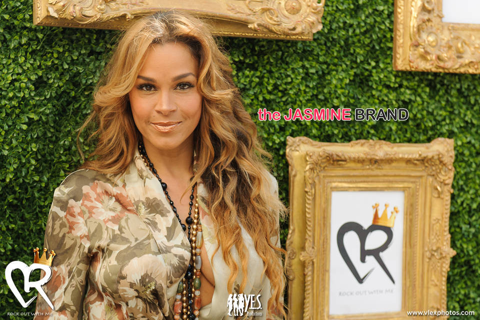 April daniels launches 39 rock out with me 39 tamar braxton for Tamar braxton tattoo