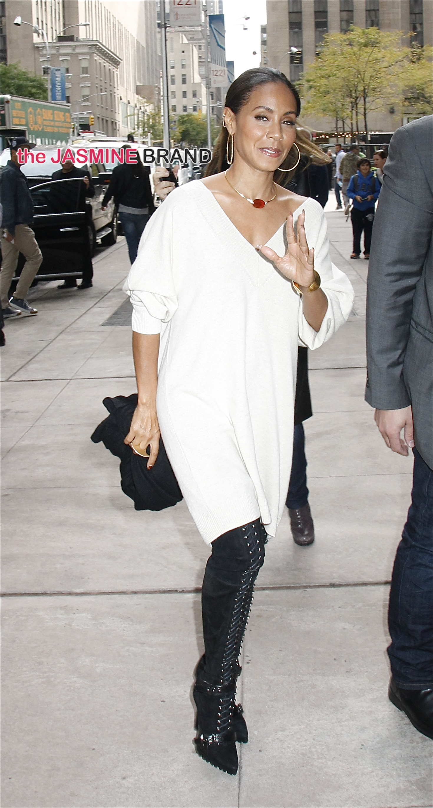 Wearing a long white sweater and black thigh-high boots, Jada Pinkett Smith arrives at SiriusXM studios in NYC