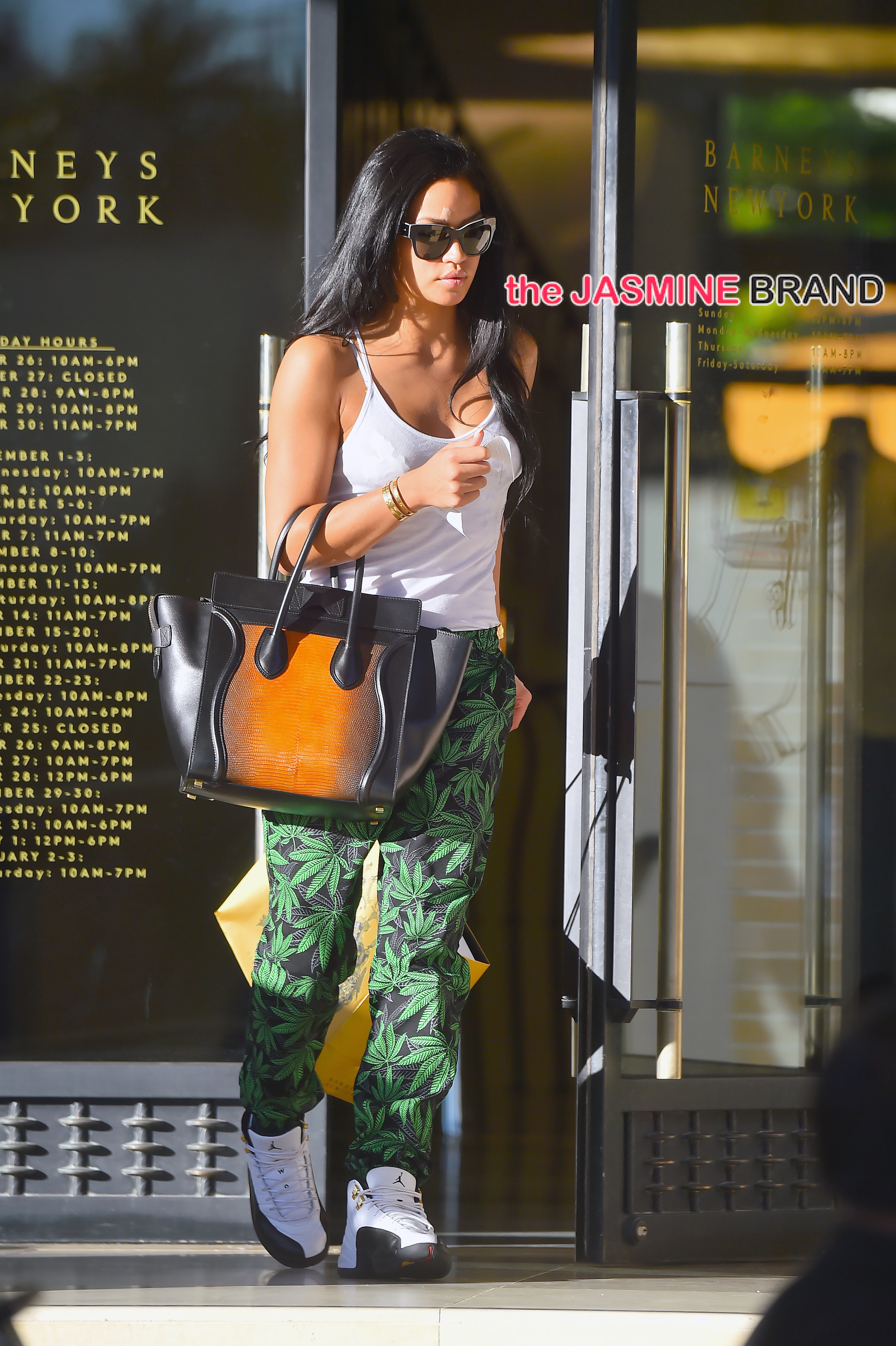 Cassie wears pants with printed marijuana leaves as she shops Barneys