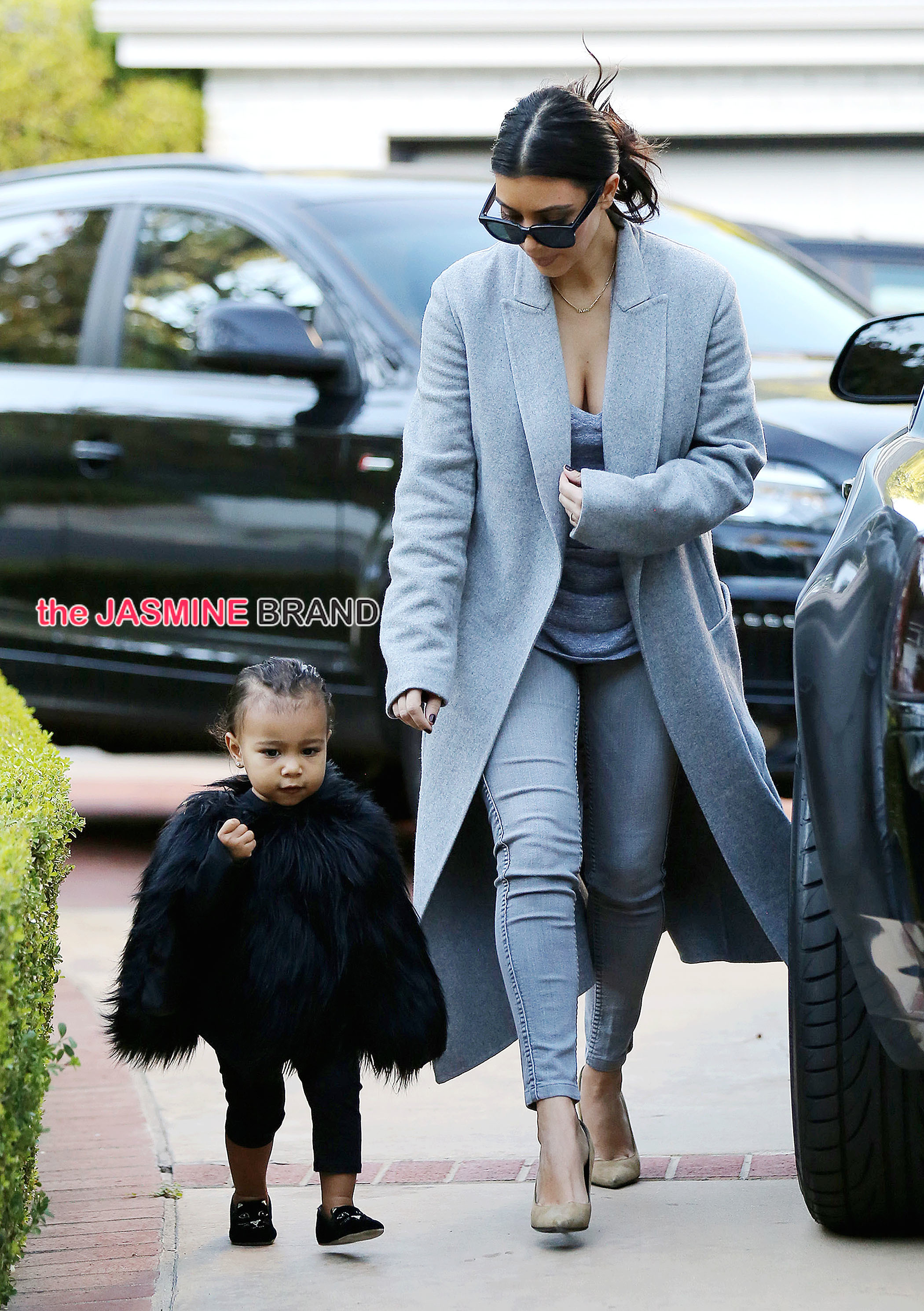 Kim Kardashian and her baby North, dressed in a black fur cape, arriving at a friend's house in Beverly Hills ****NO DAILY MAIL SALES****