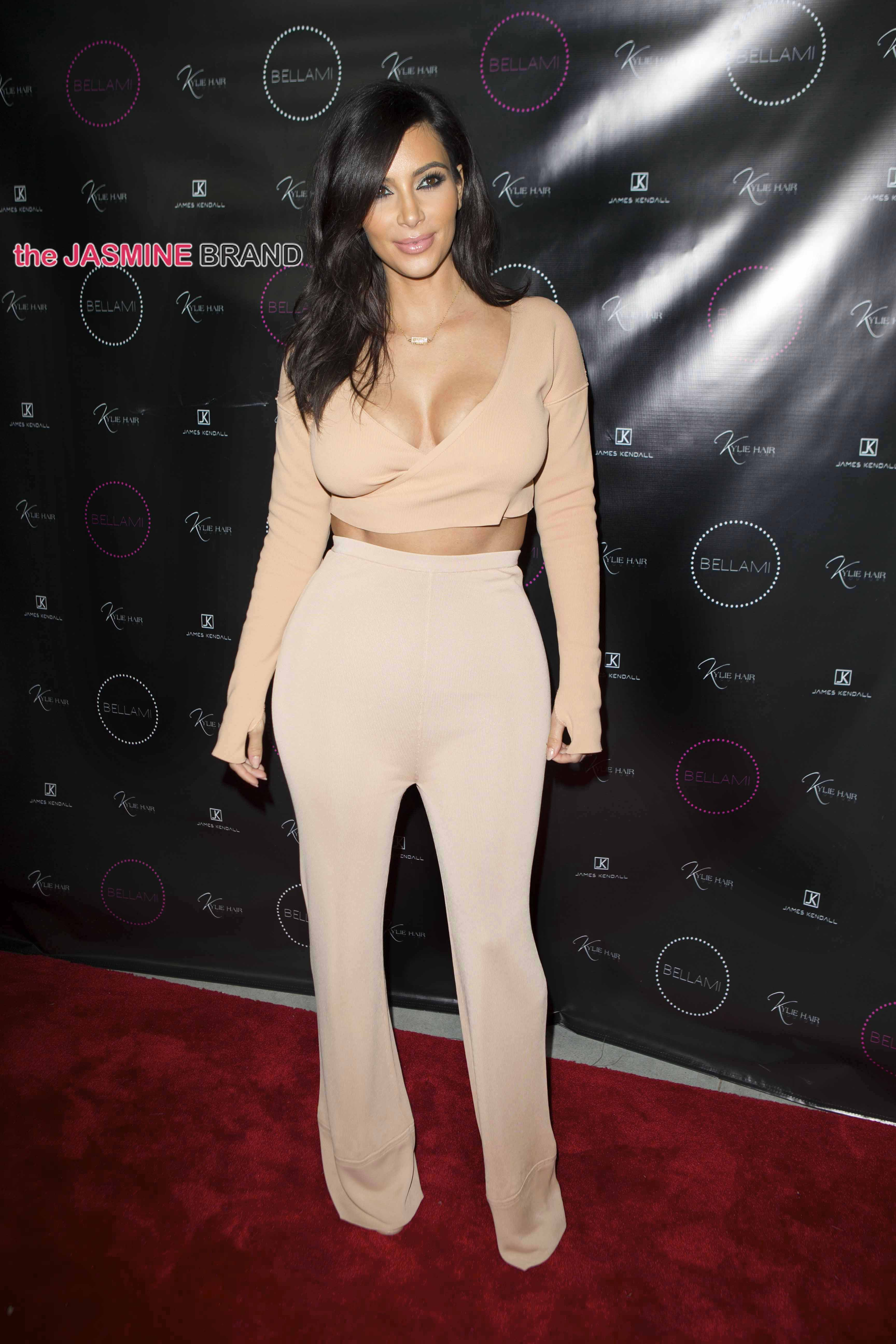 Kylie Jenner poses happily with her sisters on her big hair line extension night launch party LA