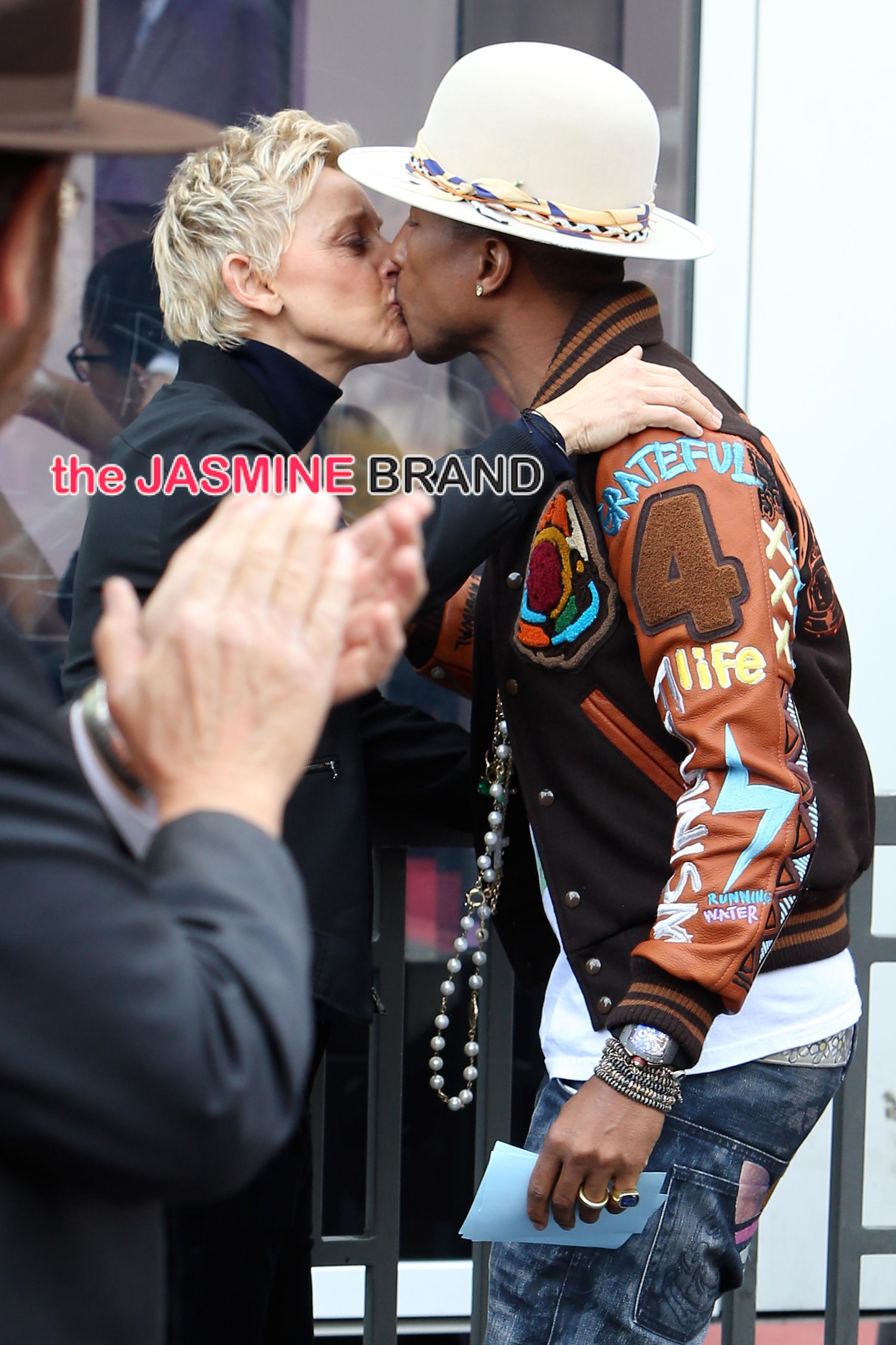 Ellen congratulates Pharrell Williams with a kiss as he accepts his star on the Hollywood Walk of Fame in Los Angeles, California