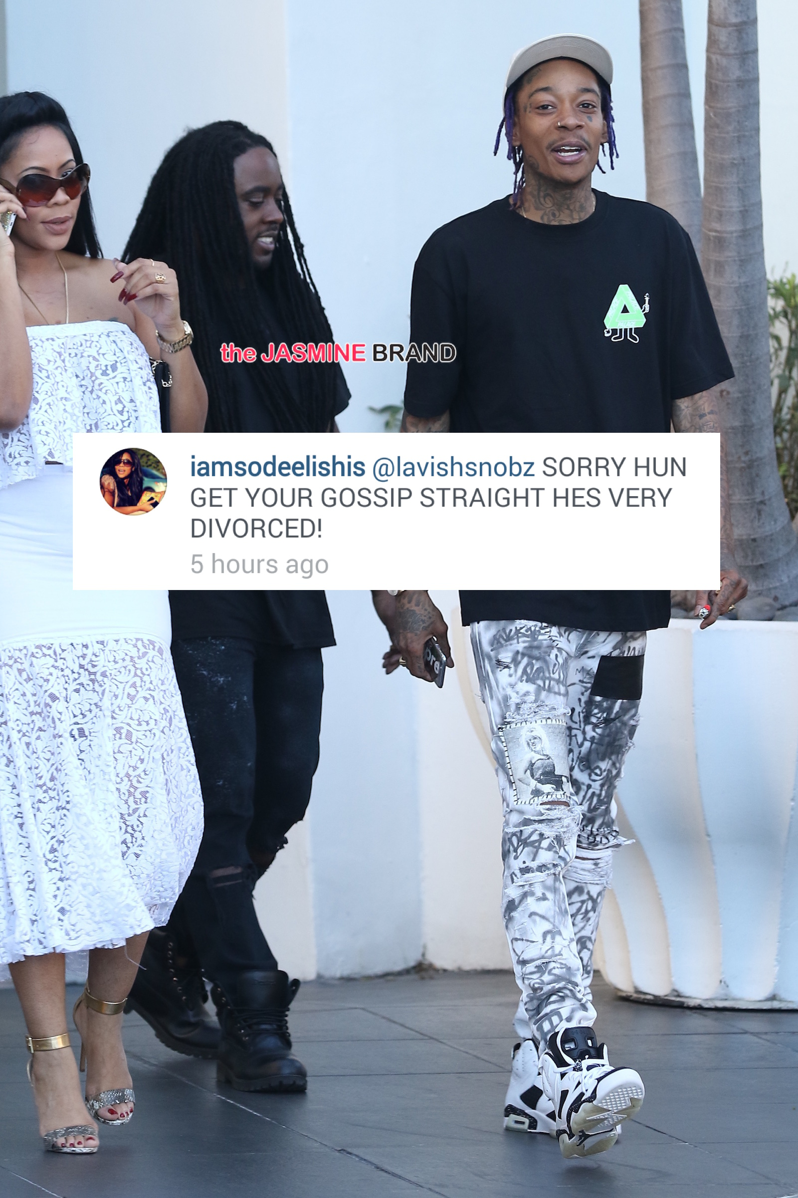 Wiz Khalifa was spotted this afternoon with a female friend in South Beach
