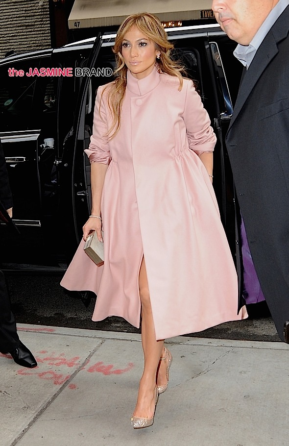 Jennifer Lopez enters her hotel wearing a pink coat in New York City