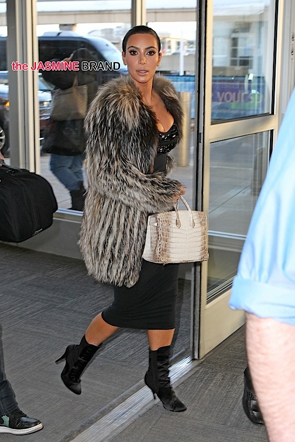 Kim Kardashian wears fur while arriving at JFK airport for a flight back to Los Angeles