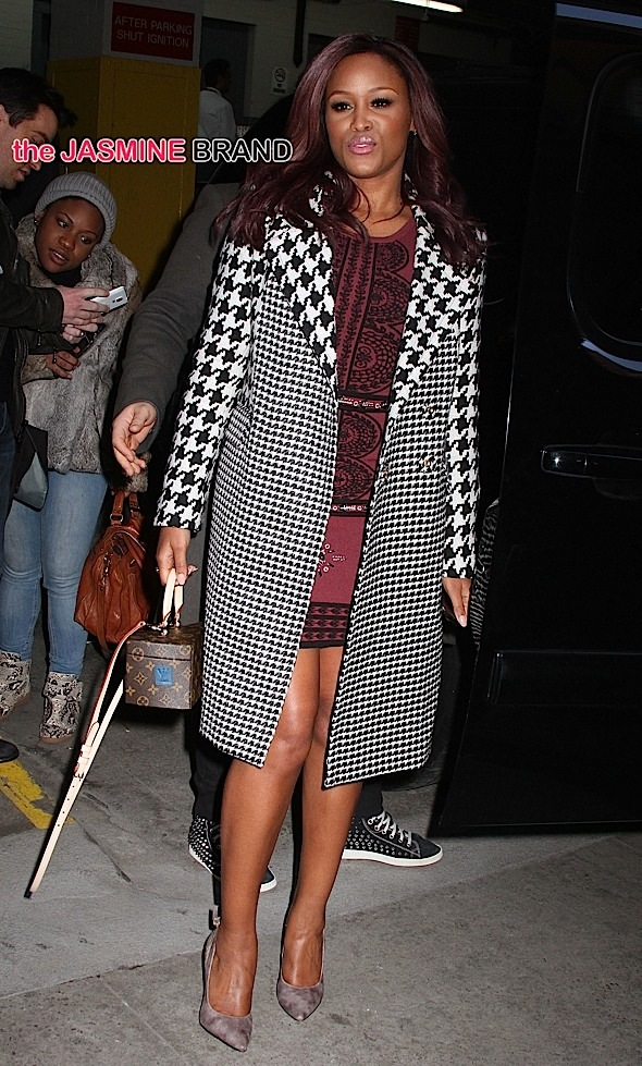 Rapper and actress Eve, wearing a black and white herringbone coat and carrying a Louis Vuitton box purse, leaves Huffington Post Live in NYC