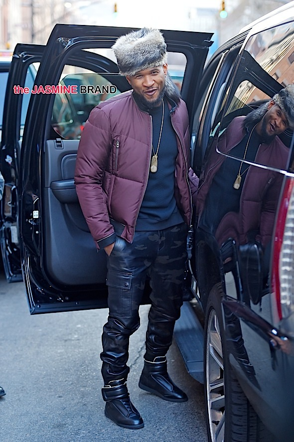 Usher steps out in a fashionable fur hat in Tribeca, NYC